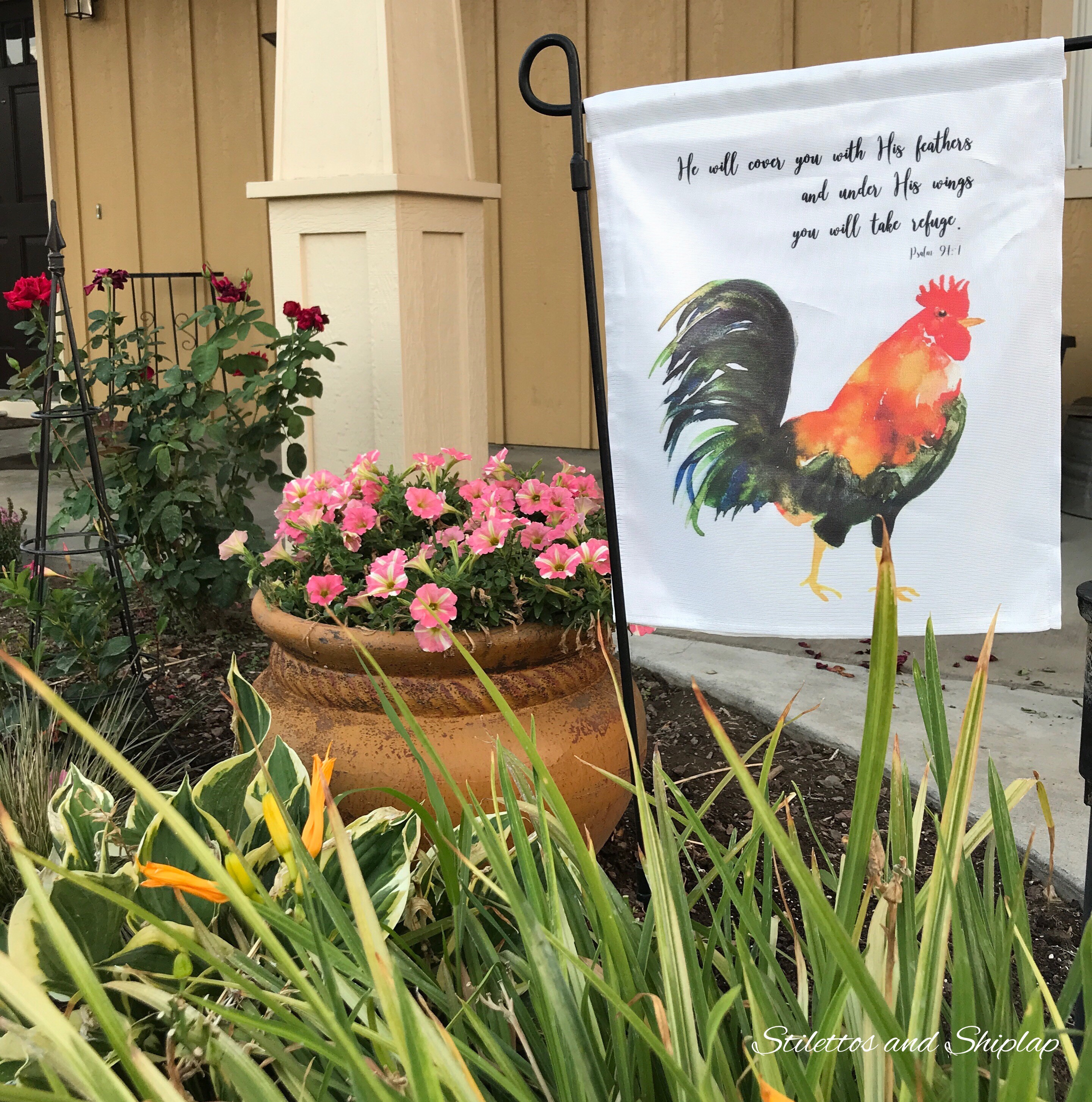 Front flowerbed and garden flag